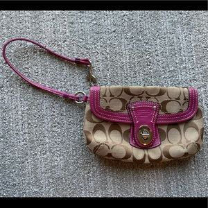 Coach wristlet with front latch pocket